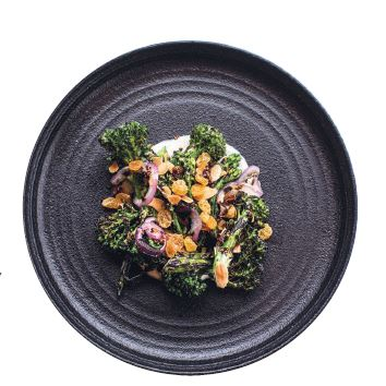 Roasted garden broccolis with red onion, sheep milk yogurt, date vinaigrette, almond and crispy quinoa PHOTO BY HEIDI HARRIS/COURTESY OF THE CHASTAIN